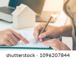 client signs home loan contract ...   Shutterstock . vector #1096207844