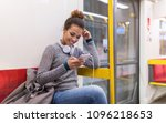 young woman using mobile phone... | Shutterstock . vector #1096218653