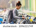 young woman renting bicycle | Shutterstock . vector #1096221749