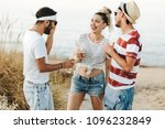 group of happy young people at... | Shutterstock . vector #1096232849
