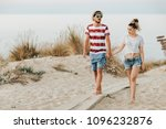 young loving couple walking on ... | Shutterstock . vector #1096232876