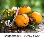 Oranges with cloves - stock photo