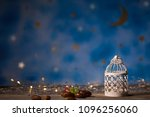 dates and candle holder on a... | Shutterstock . vector #1096256060