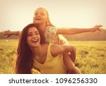 flying kid girl laughing on the ... | Shutterstock . vector #1096256330
