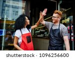 positive caucasian waiter and... | Shutterstock . vector #1096256600