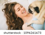 adorable woman hugging her pug... | Shutterstock . vector #1096261673