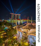Small photo of SINGAPORE CITY, SINGAPORE - APRIL 17, 2018: Spectra Light and Water Show Marina Bay Sand Casino Hotel Downtown Singapore on APRIL 17, 2018