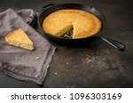 Stock photo homemade buttermilk cornbread in a cast iron skillet on dark background 1096303169
