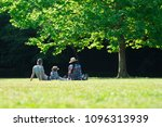 family relaxing in lawn | Shutterstock . vector #1096313939