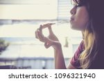 happy young woman eating... | Shutterstock . vector #1096321940