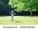 girl playing with a jump rope | Shutterstock . vector #1096338260
