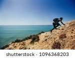 man climbing and walking on... | Shutterstock . vector #1096368203