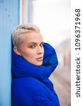 Small photo of Portrait of young beautiful woman with short hairs - Influencer posing for a fashion advertising campaign