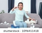 allergic cat lady. young... | Shutterstock . vector #1096411418