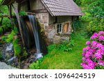 a small water mill in germany ... | Shutterstock . vector #1096424519