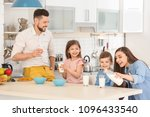 happy family having breakfast... | Shutterstock . vector #1096433540