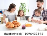 happy family having breakfast... | Shutterstock . vector #1096433546