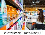 young woman in store with... | Shutterstock . vector #1096435913