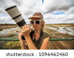 photographer woman on a... | Shutterstock . vector #1096462460