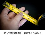 Small photo of Tape measure ruler, extended to 6 inch mark.