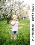 small child walks in the park... | Shutterstock . vector #1096540298