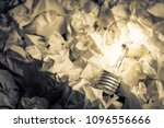 light bulb glowing on pile of... | Shutterstock . vector #1096556666