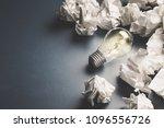 Light Bulb Glowing Among The...