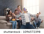 happy sport fans with colored... | Shutterstock . vector #1096572398