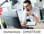 a young man in glasses stands... | Shutterstock . vector #1096575230