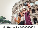 young couple at the colosseum ... | Shutterstock . vector #1096580459