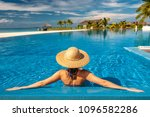 woman with sun hat at beach...   Shutterstock . vector #1096582286