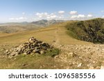 cairn next to a stoney footpath ... | Shutterstock . vector #1096585556