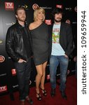 "Small photo of LOS ANGELES, CA - NOVEMBER 10, 2009: ""Accidentally on Purpose"" stars Jenna Elfman, Jon Foster (left) & Nicholas Wright at TV Guide Magazine's Hot List Party at the SLS Hotel, Beverly Hills."