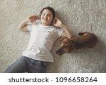 top view of happy boy listening ... | Shutterstock . vector #1096658264