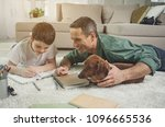 joyful man is helping his son... | Shutterstock . vector #1096665536