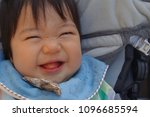 baby laughing at a stroller  10 ... | Shutterstock . vector #1096685594