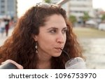 attractive brunette woman... | Shutterstock . vector #1096753970