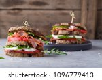 sandwiches with bacon  tomato ... | Shutterstock . vector #1096779413
