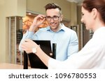 female ophthalmologist helping... | Shutterstock . vector #1096780553