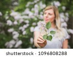 girl holding a sprig of lilac | Shutterstock . vector #1096808288