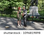 Small photo of August 13, 2015 - New York, New York: Two musicians play music and sing along The Mall and Literary Walk in Central Park.