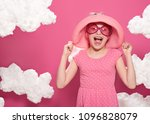 fashionable girl posing on a... | Shutterstock . vector #1096828079