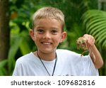 Boy Holding A Giant Tree Frog...