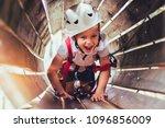 little boy climbing in... | Shutterstock . vector #1096856009