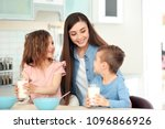 happy family having breakfast... | Shutterstock . vector #1096866926