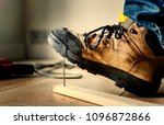 man stepping on a nail | Shutterstock . vector #1096872866