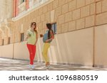 two pregnant women stand on the ... | Shutterstock . vector #1096880519