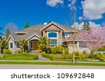 luxury house at sunny day in... | Shutterstock . vector #109692848