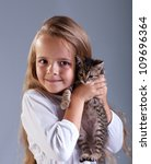 Portrait of adorable little girl and her kitten - stock photo