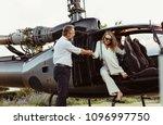pilot holding hand of a woman... | Shutterstock . vector #1096997750
